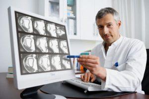 Doctor pointing to ultrasound image --- Image by © Oliver Eltinger/Corbis
